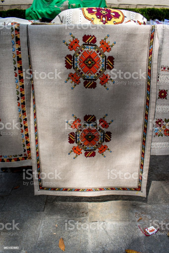 The bulgarian embroidery is a stitch on a fabric decoration. It applies almost all the clothes, part of the Bulgarian folk costume, both in men's and women's clothing all over Bulgaria. - Royalty-free Art Stock Photo