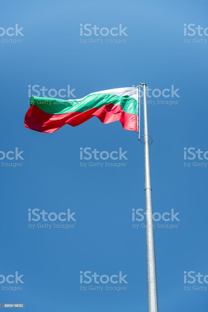 The Bulgarian national flag waving high in the sky stock photo