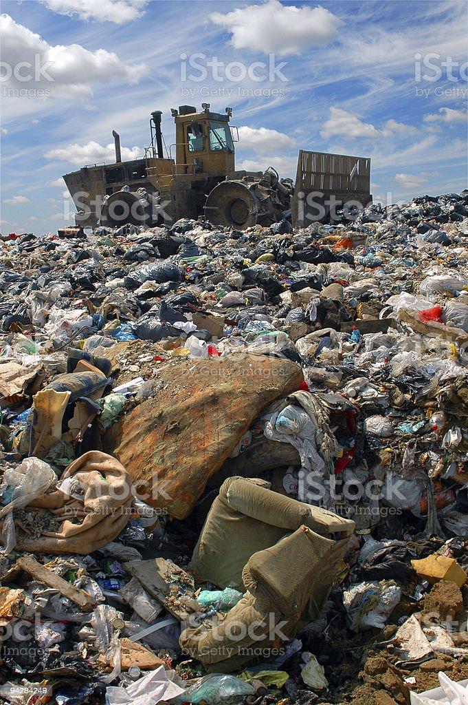 The bulldozer on a garbage dump stock photo