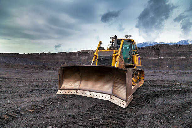 The bulldozer working in coal mines stock photo