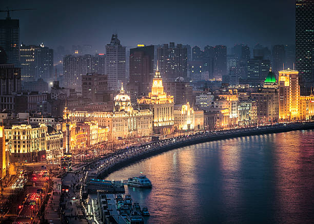 The Bund in Shanghai High angle night view looking onto the famous, historic architecture of The Bund (Zhongshan Road), facing the Huangpu river. the bund stock pictures, royalty-free photos & images