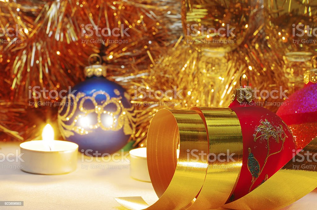 The burning candles, balls and ribbons it are Christmas royalty-free stock photo