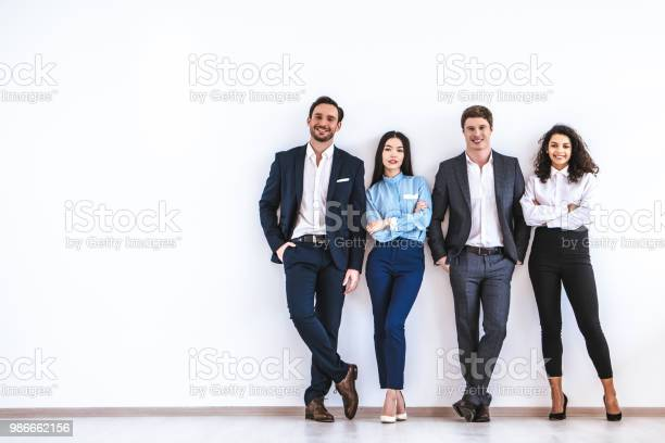 The business people standing on the white wall background picture id986662156?b=1&k=6&m=986662156&s=612x612&h=tfr2uwkx6mlwk738he0g2nn6w6cqdidhb1tygdyo6ac=