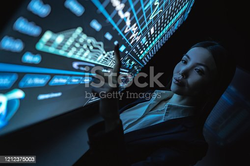 847519080 istock photo The business woman works with graphics on a sensor screen 1212375003