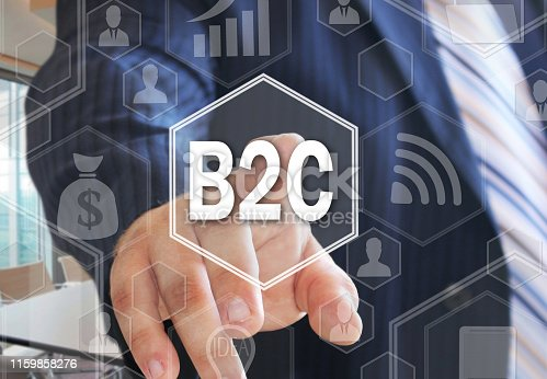 The businessman chooses  B2C, Business-to-consumer on the touch screen with a futuristic background .The concept B2C, Business-to-consumer .