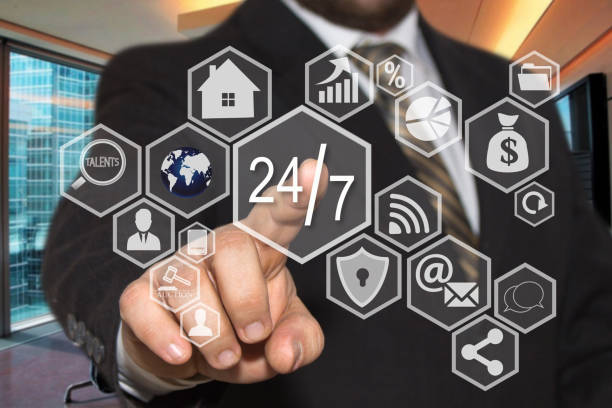 The businessman chooses  button  24 hours 7 days web service icon on the touch screen with a futuristic background .The concept  24 hours 7 days web service. stock photo