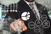 istock The businessman chooses  button  chart, business diagram on the touch screen with a futuristic background .The concept  of data collection. 936222652