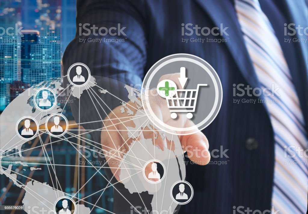 The businessman chooses on the shopping cart on the touch screen with a futuristic background. The concept of online . Auctions. online store. Shopping cart icon. Ecommerce. royalty-free stock photo