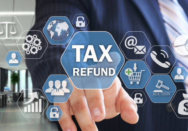 The businessman chooses TAX REFUND on the virtual screen in social network connection. stock photo