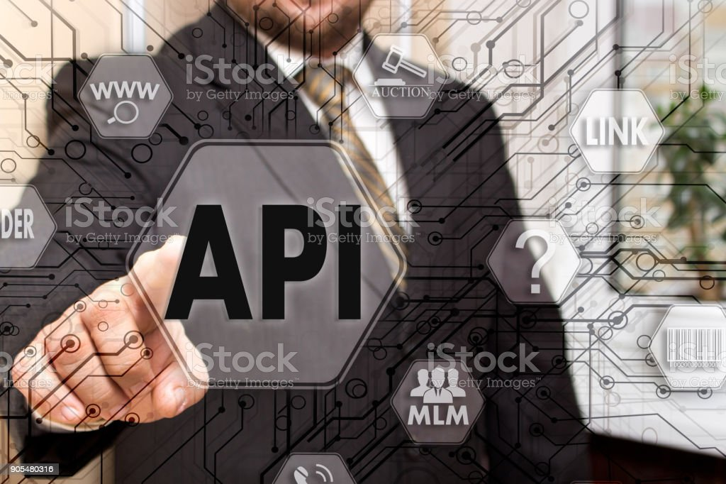 The businessman chooses the API, Application Programming Interface on a touch screen. Concept API stock photo