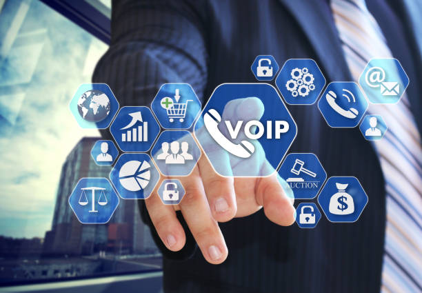 The businessman chooses VOIP on the virtual screen in social network connection. stock photo