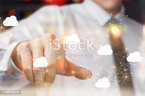 The businessman clicks on the cloud in network on blurred background.