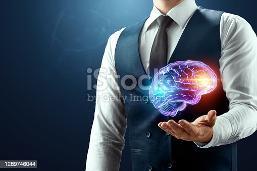 The businessman has a brain hologram in his palm. Concept of mind, consciousness, outsourcing services