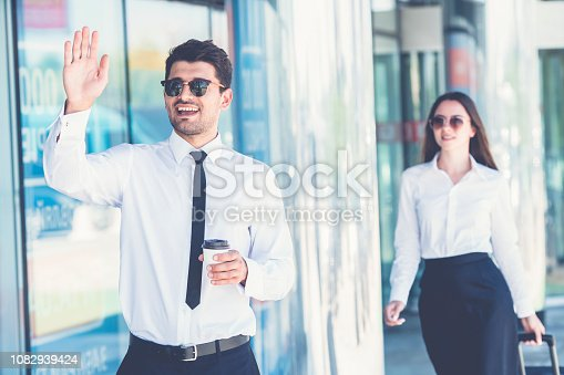 The businessman in sunglasses gesture near the woman