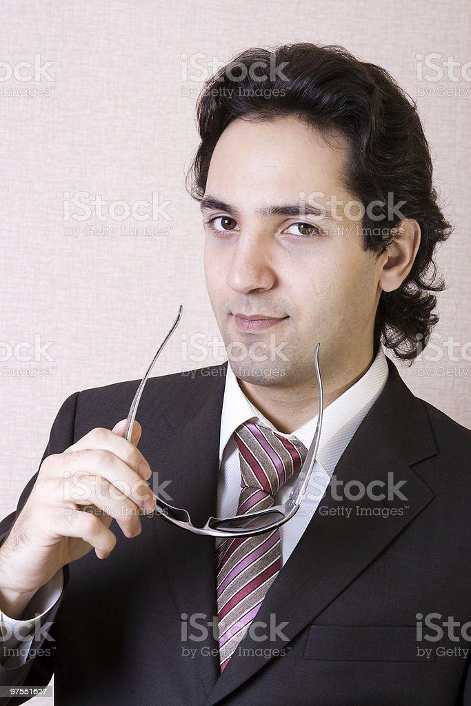 L'homme d'affaires en lunettes de soleil photo libre de droits