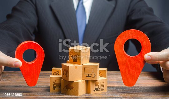 The businessman indicates the points of the route of supply and delivery of goods. Distribution. Trade logistics. Task of automatically delivering orders to customers in the shortest possible time.