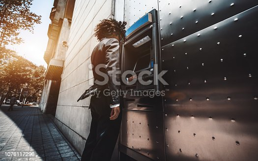 istock The businessman is using street ATM 1076117296