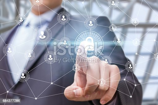 istock The businessman puts the security of the network by . 684377286