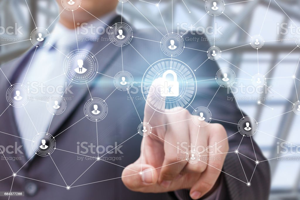 The businessman puts the security of the network by . stock photo