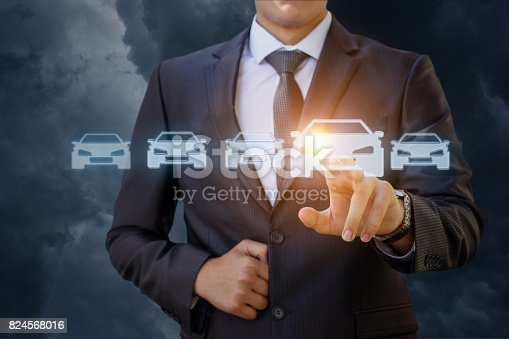 istock The businessman selects a car . 824568016