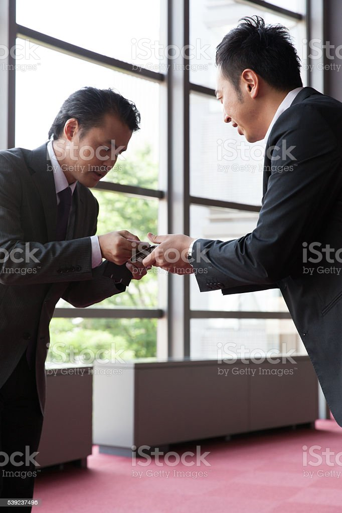 the businessman standing  in the lobby at office royalty-free stock photo