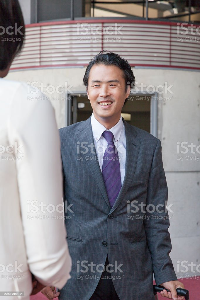the businessman taaliking  in the lobby at office royalty-free stock photo
