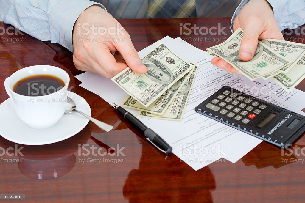 The businessman with money stock photo