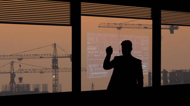 the businessman working on a virtual screen on building construction background - man look sky scraper foto e immagini stock