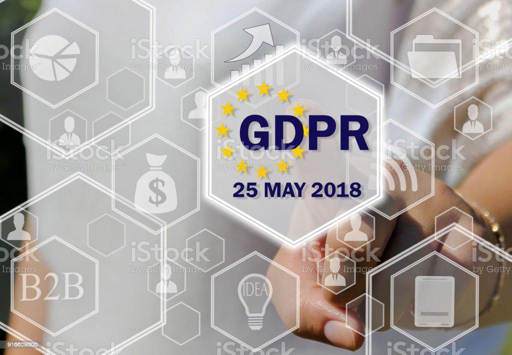 A empresária escolhe o PIBR na tela de toque. Conceito de regulamento de proteção de dados geral 25 de maio de 2018. - foto de acervo