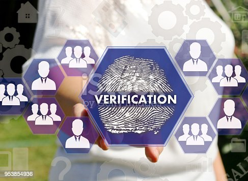 896596886 istock photo The businesswoman clicks the VERIFICATION button and the finger print on the touch screen. The concept of fingerprint scanning for secure access to the web network. 953854936