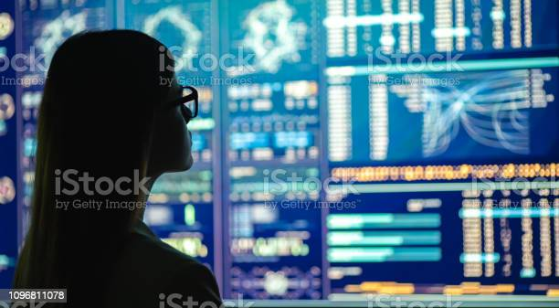 The Businesswoman In Glasses Standing Near The Display Stock Photo - Download Image Now