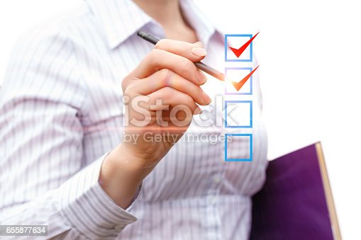 istock The businesswoman notes the work done. 655877634
