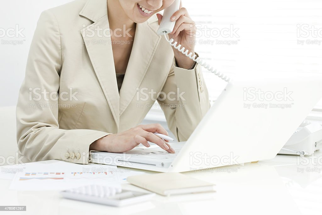 The businesswoman who operates a note PC royalty-free stock photo