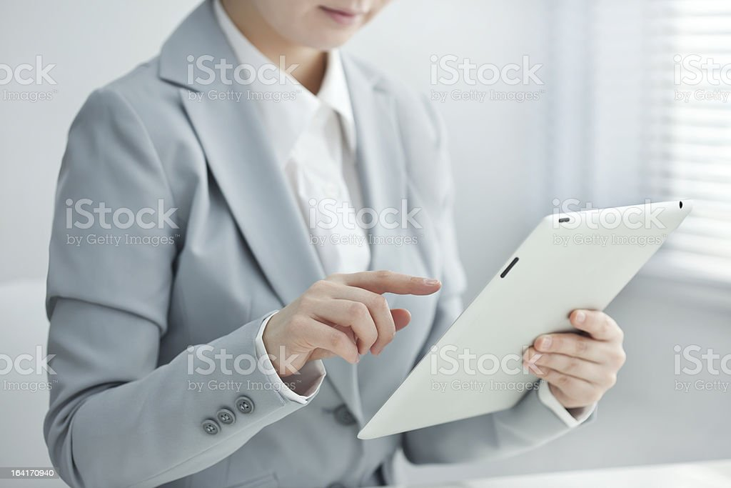 The businesswoman who operates a tablet PC royalty-free stock photo