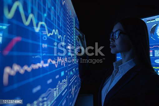 847519080 istock photo The businesswoman works with blue screen 1212374962