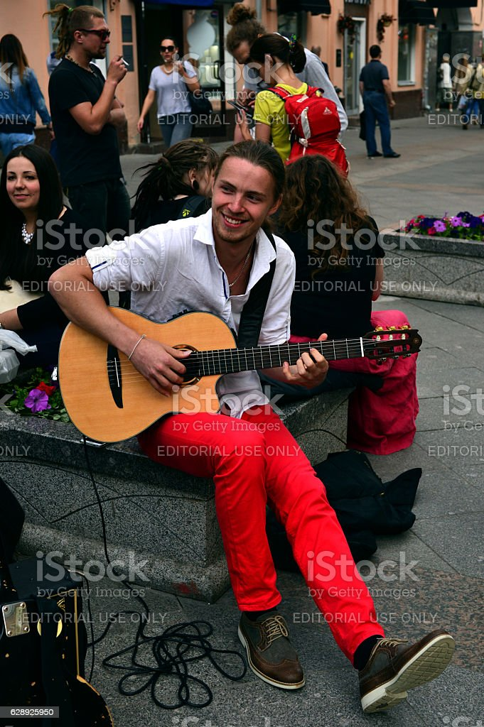 The  busker (street musician) with guitar stock photo