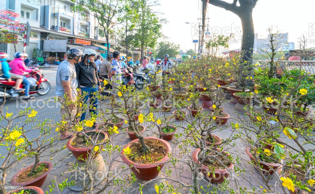 The bustle of buying flowers at flower market, locals buy flowers stock photo
