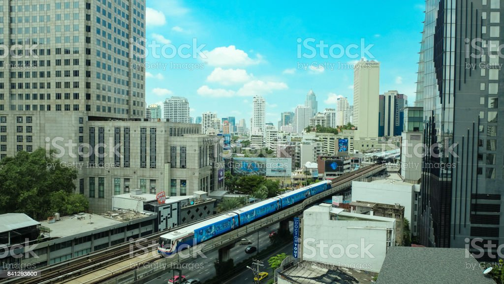 The bustling downtown Bangkok with Skytrain stock photo