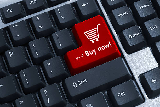 The Buy now red button on keyboard Concept design keyboard of web shopping buy single word stock pictures, royalty-free photos & images