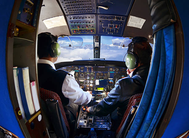 The cabin of the old passenger plane with pilots stock photo