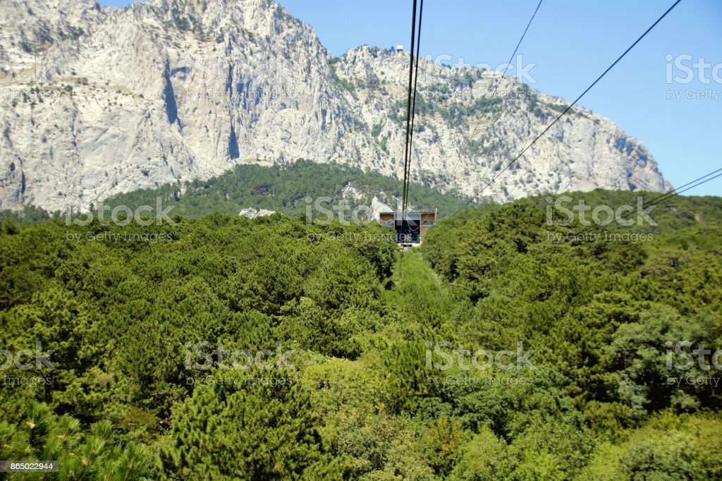 The cable car in Crimea Ai-Petri on a background of mountains covered with clouds stock photo