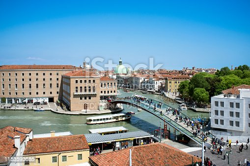 10 - May - 2019, Venice, Italy - PIazzale Roma, The Ponte di Calatrava or PonteDellaCostituzione in Piazzale Roma. This fourth bridge over the Grand Canal is made of glass and steel. It connects Piazzale Roma and the train station Venezia Santa Lucia.