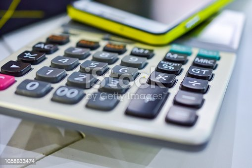 istock The calculator is placed on the desk. 1058633474