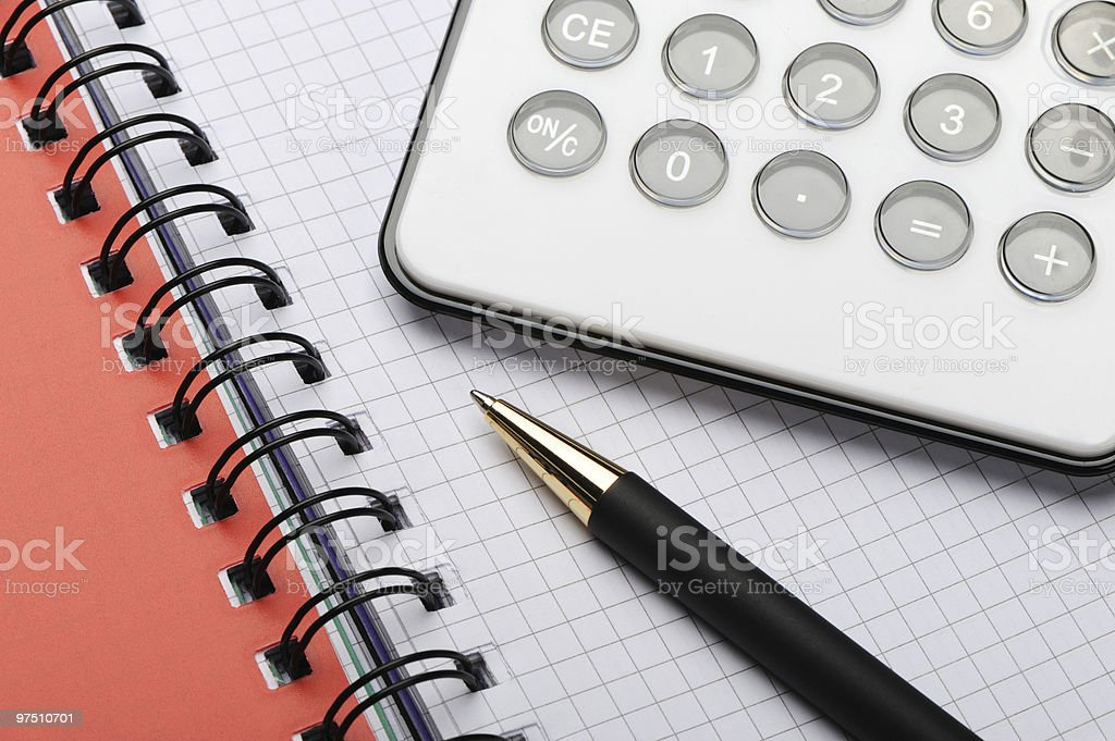 The calculator with pen on a notebook royalty-free stock photo