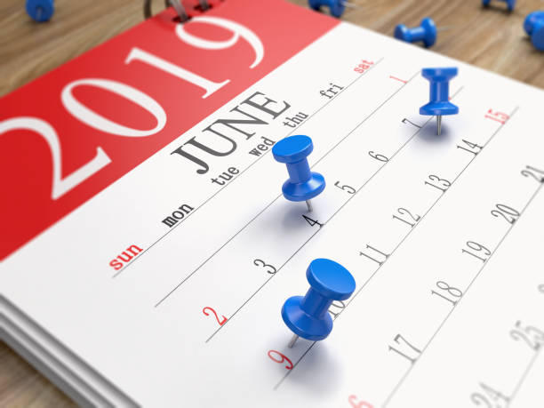 the calendar on the desk - june stock photos and pictures