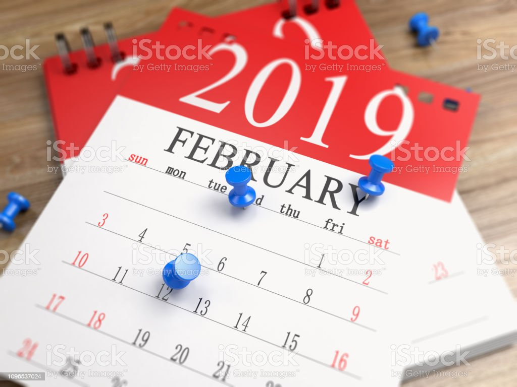 The calendar on the desk. Focused image