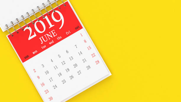 the calendar on yellow background - june stock photos and pictures