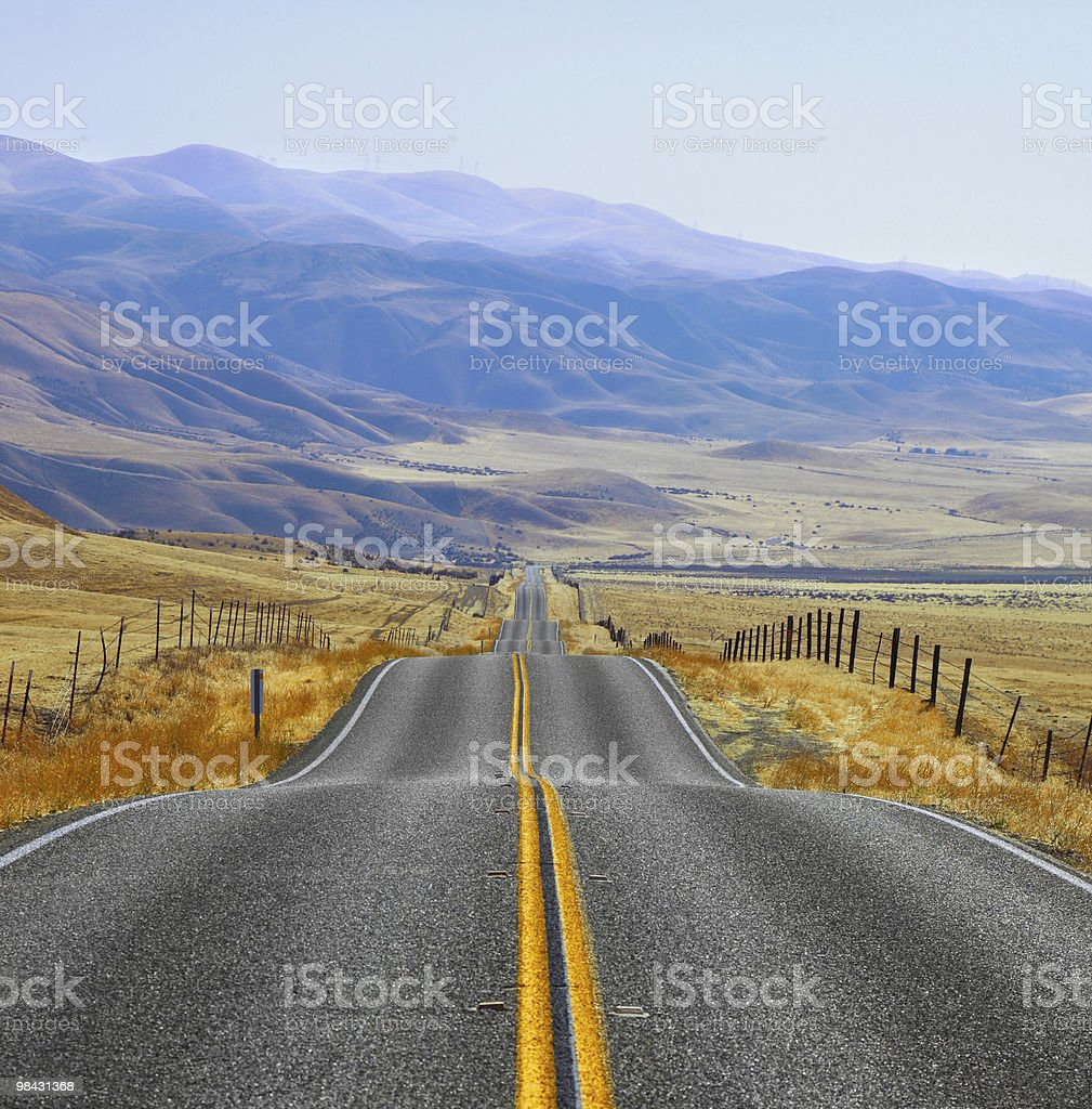 The Californian prairie, mountains, road and fencings royalty-free stock photo