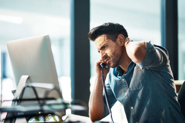 the call that no one likes to get - frustrated man stock photos and pictures