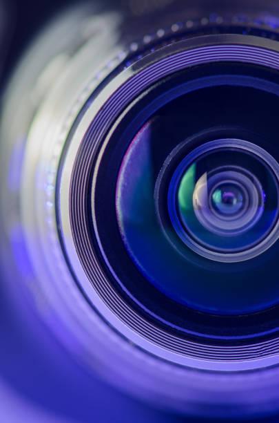 the camera lens and light blue. vertical photo - camera imagens e fotografias de stock